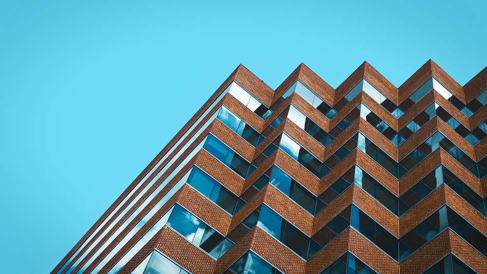 low angle photography of building under clear blue sky at daytime