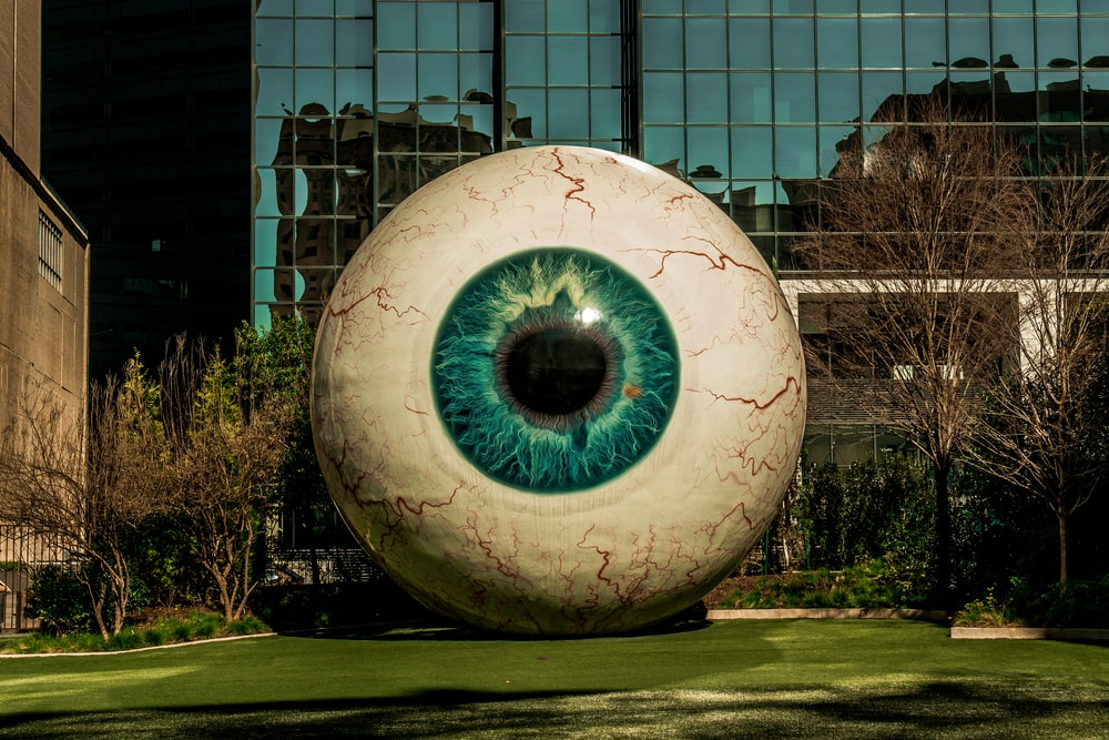 eyeball statue near building