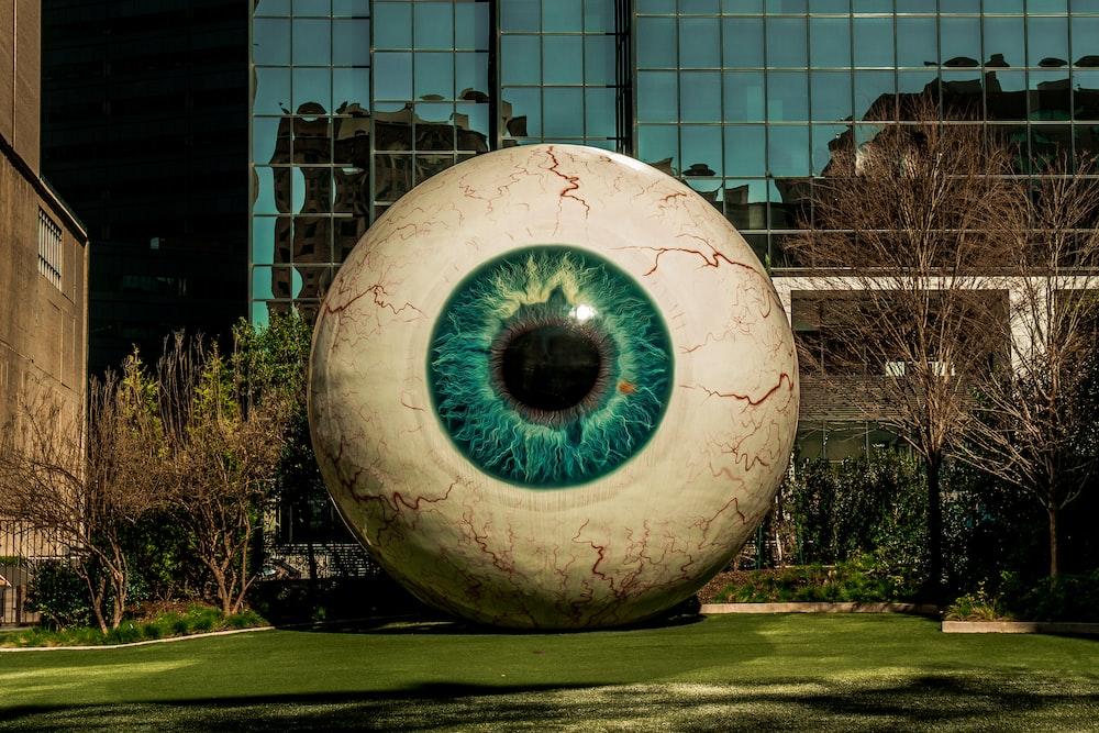eyeball statue near building