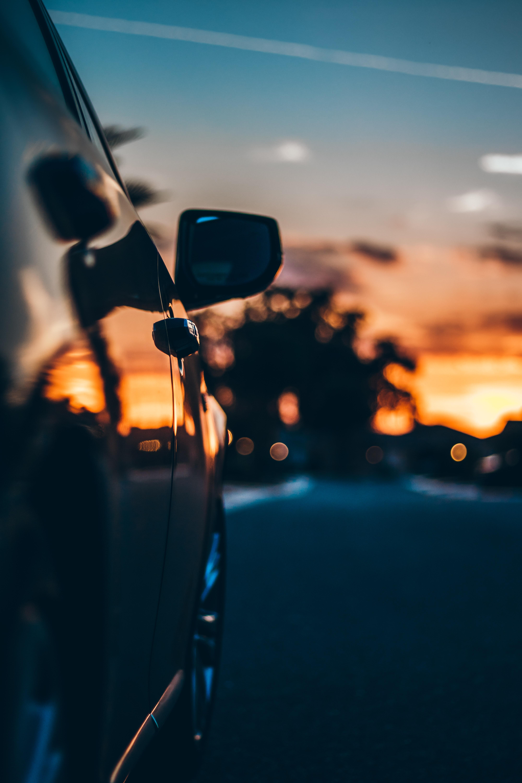sunset reflecting on shiny black car door