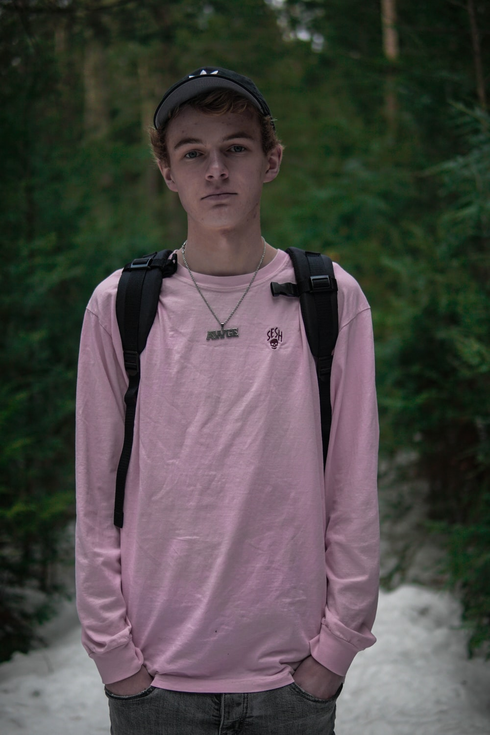 man wearing pink crew-neck shirt