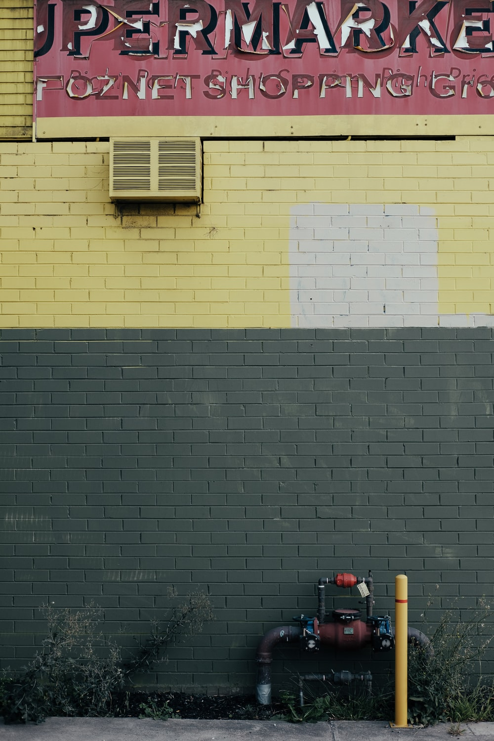green and yellow painted concrete wall