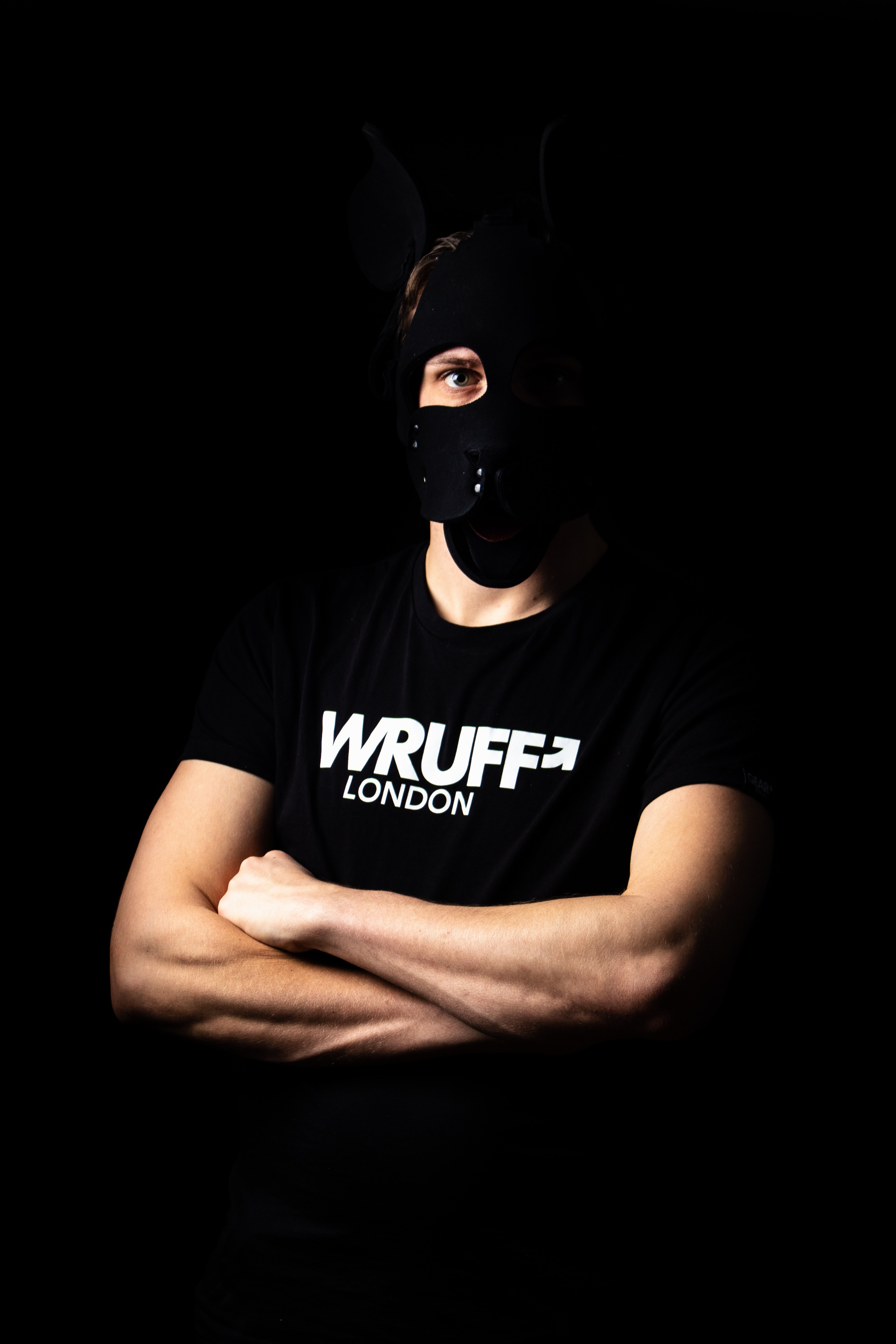 person wearing white and black Wruff crew-neck shirt