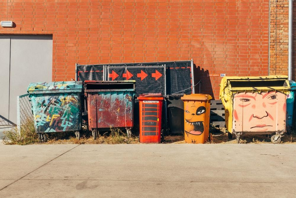 assorted-color trash bins