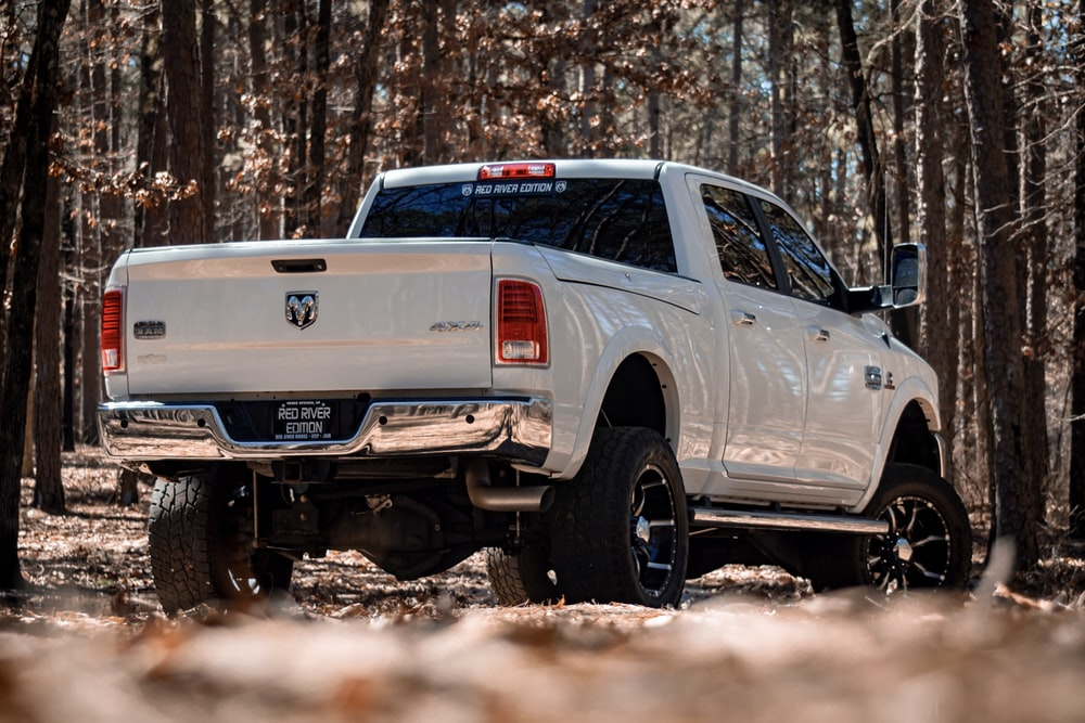 white Dodge crew cab pickup truck