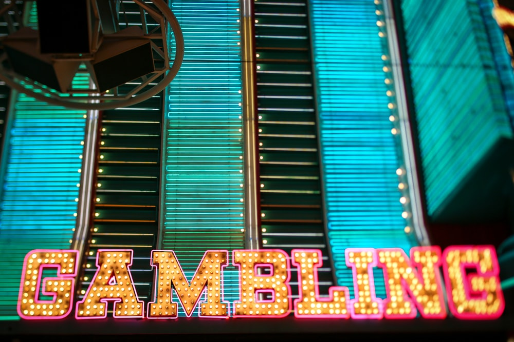 yellow and pink Gambling lighted signage