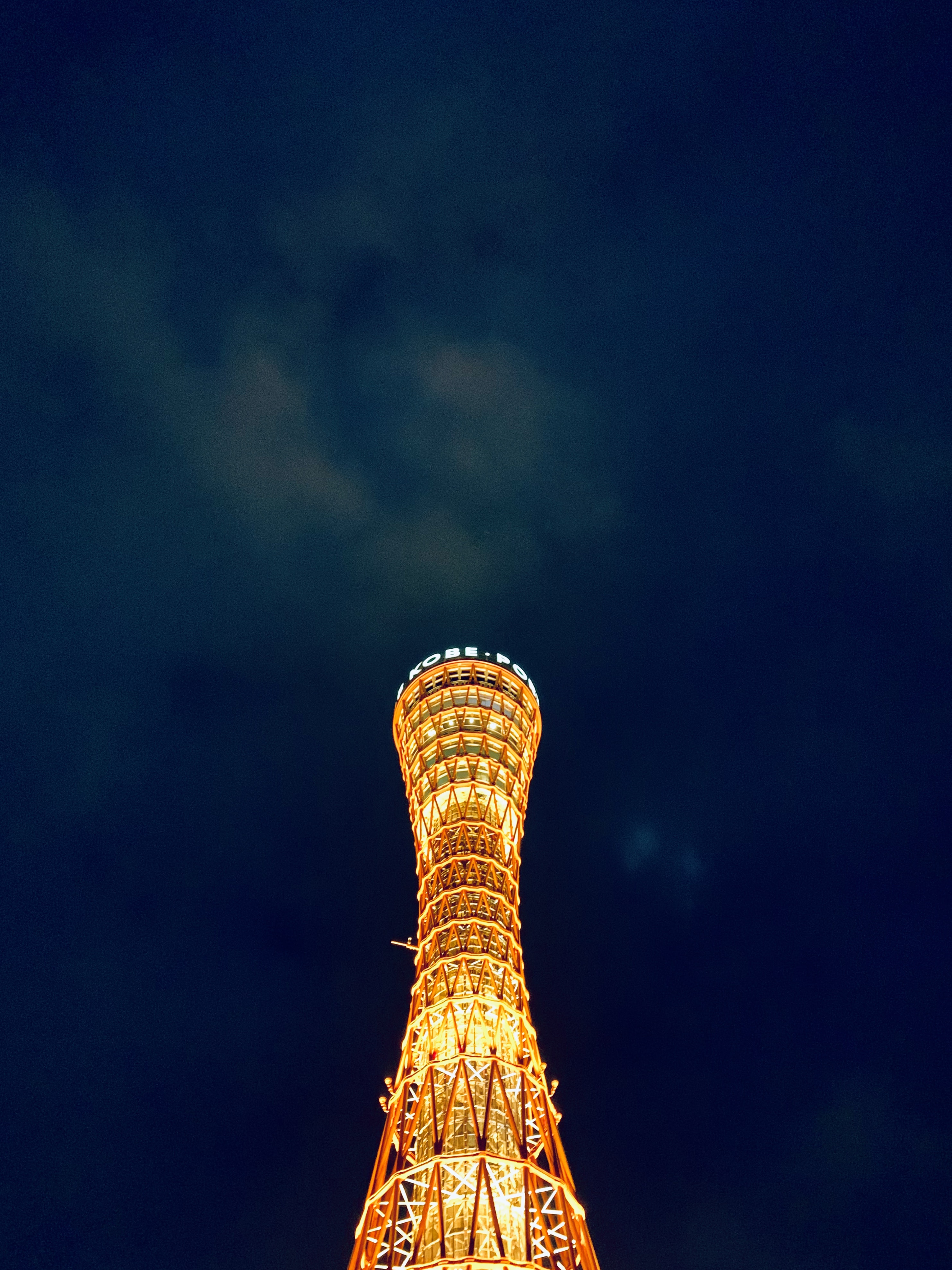 low-angle photography of lighted tower