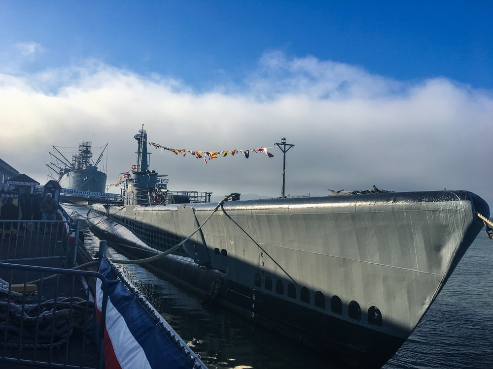 gray ship beside dock