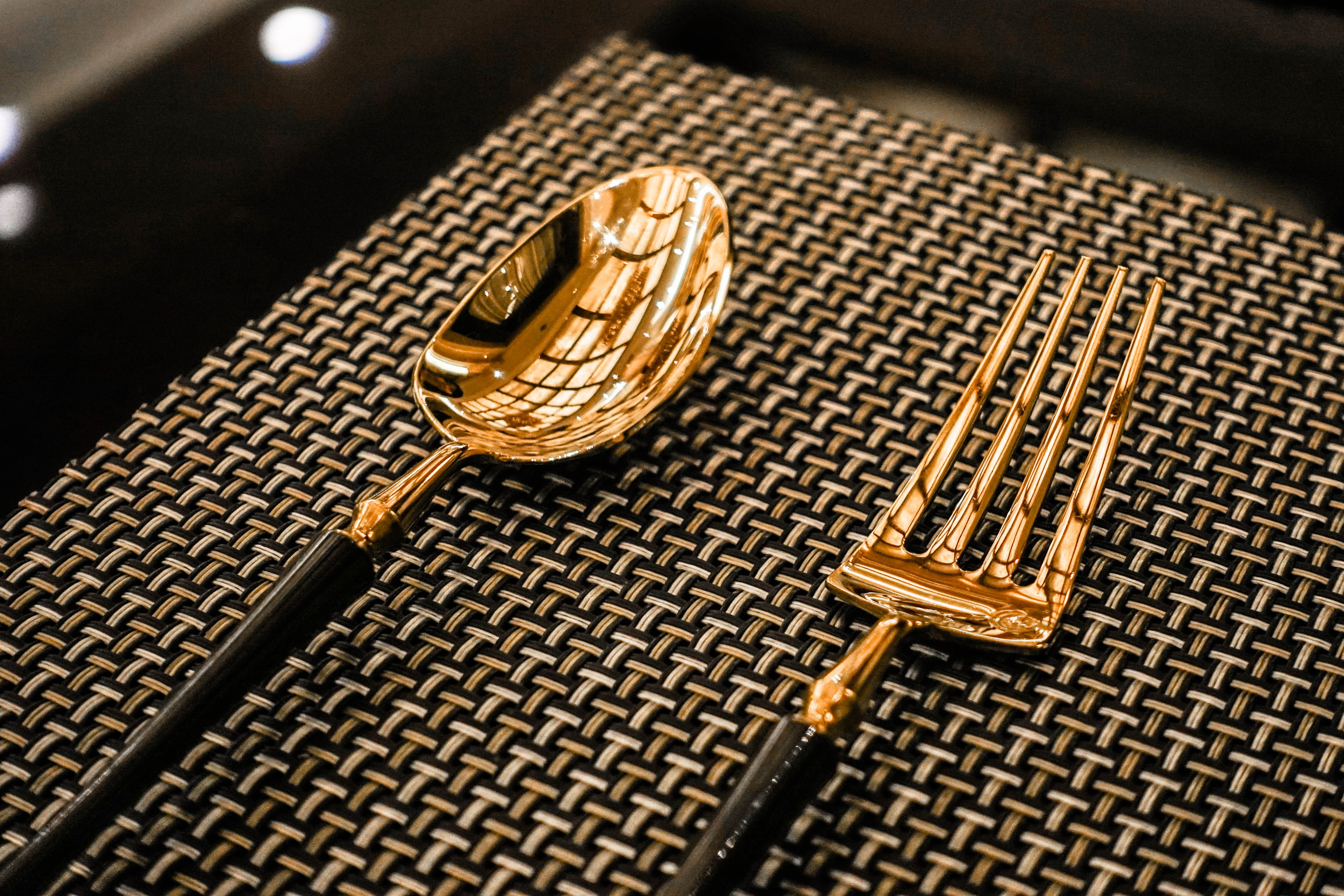 two gold-colored spoon and fork
