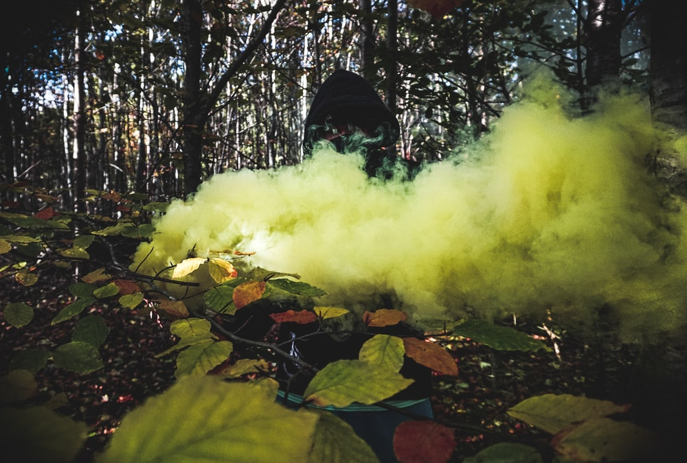 person covered with yellow smoke