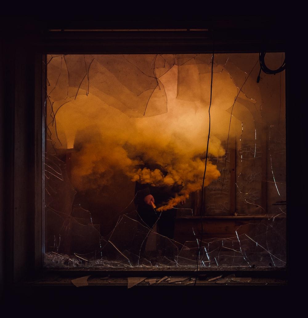 broken glass window near smoke