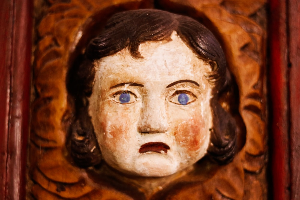 girl face wood carved