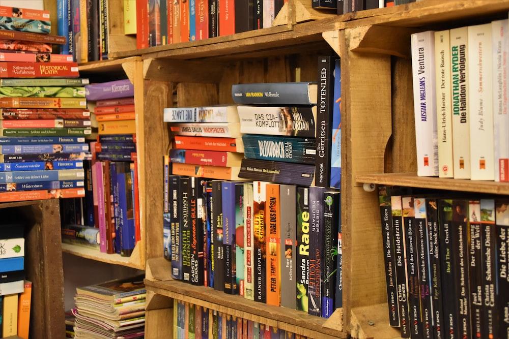 pile of books on bookshelf