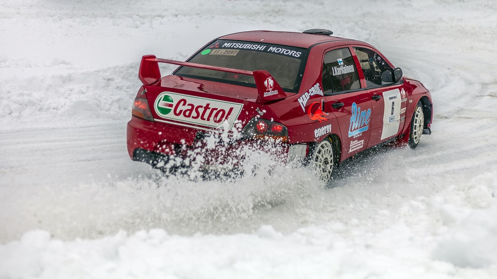 red racing car on snow field