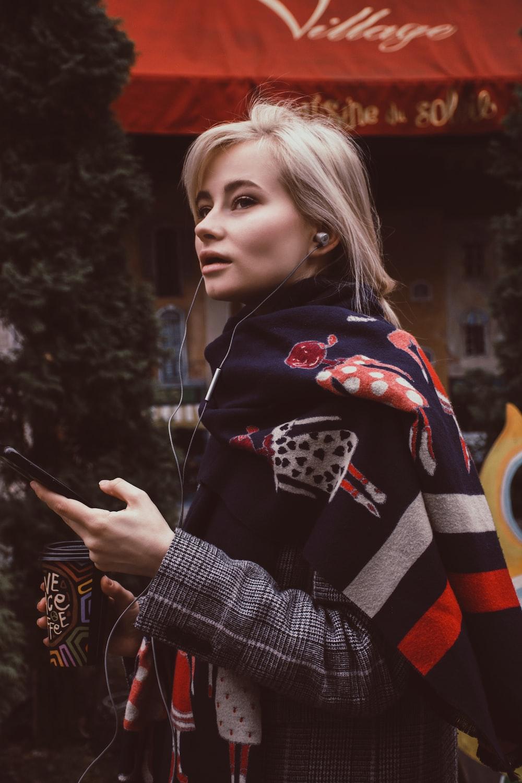 woman wearing earphones and scarf
