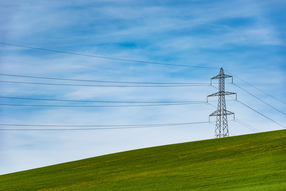 electrical tower on grass field