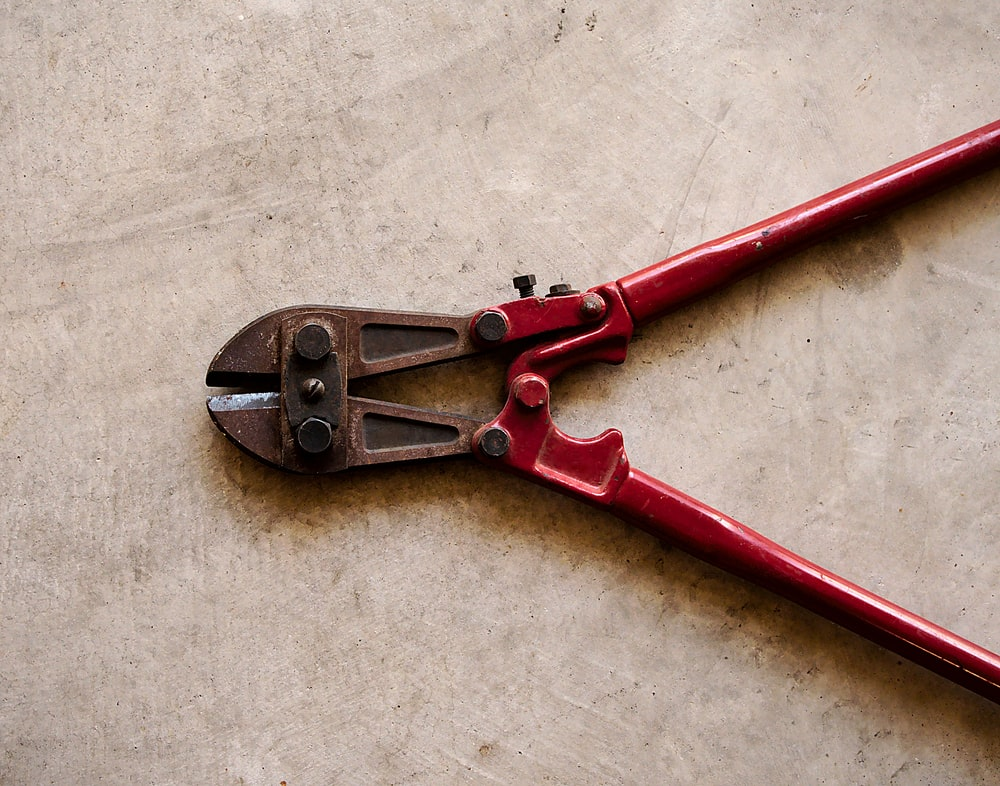 red bolt cutter on floor