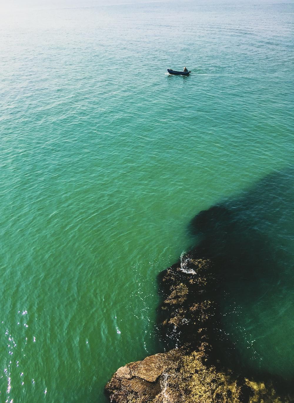 clear blue sea beside cliff