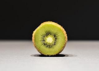 sliced kiwi on white surface