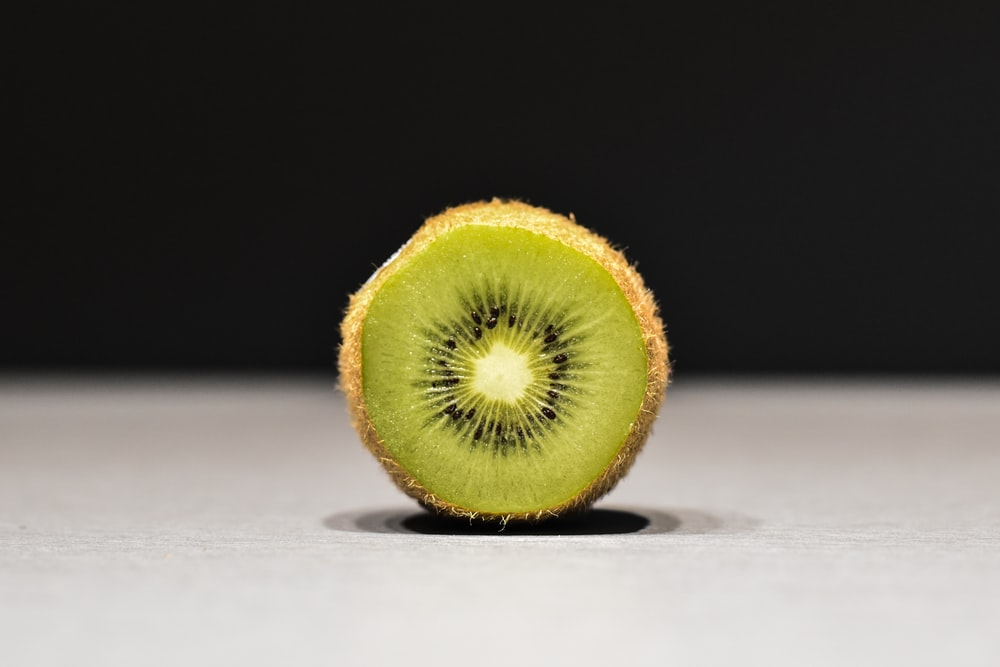 sliced kiwi on white surface