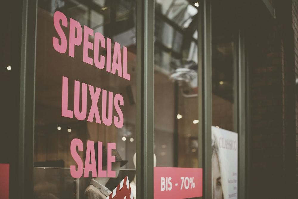 Special Luxus Sale vinyl sticker on glass wall