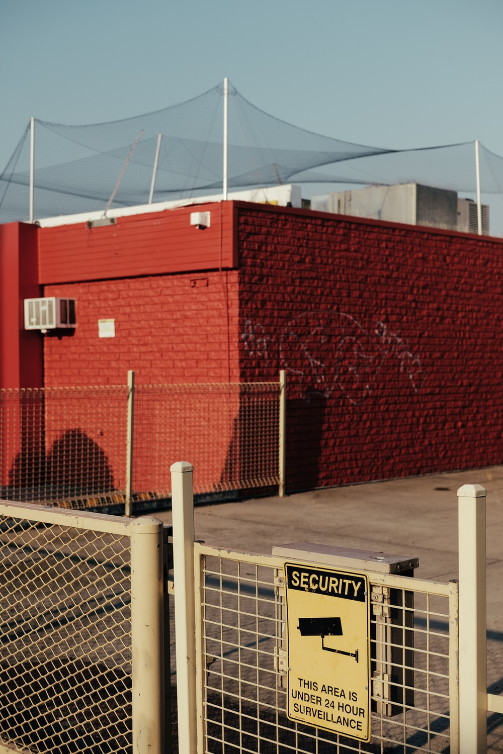 red brick wall with net