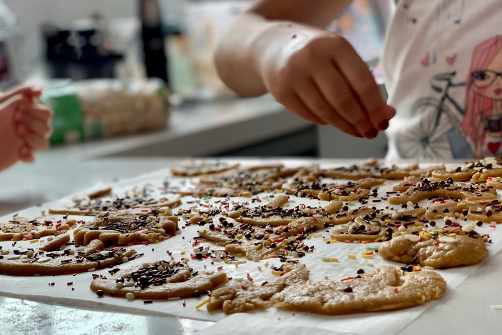 cookies with sprinkles on white mat