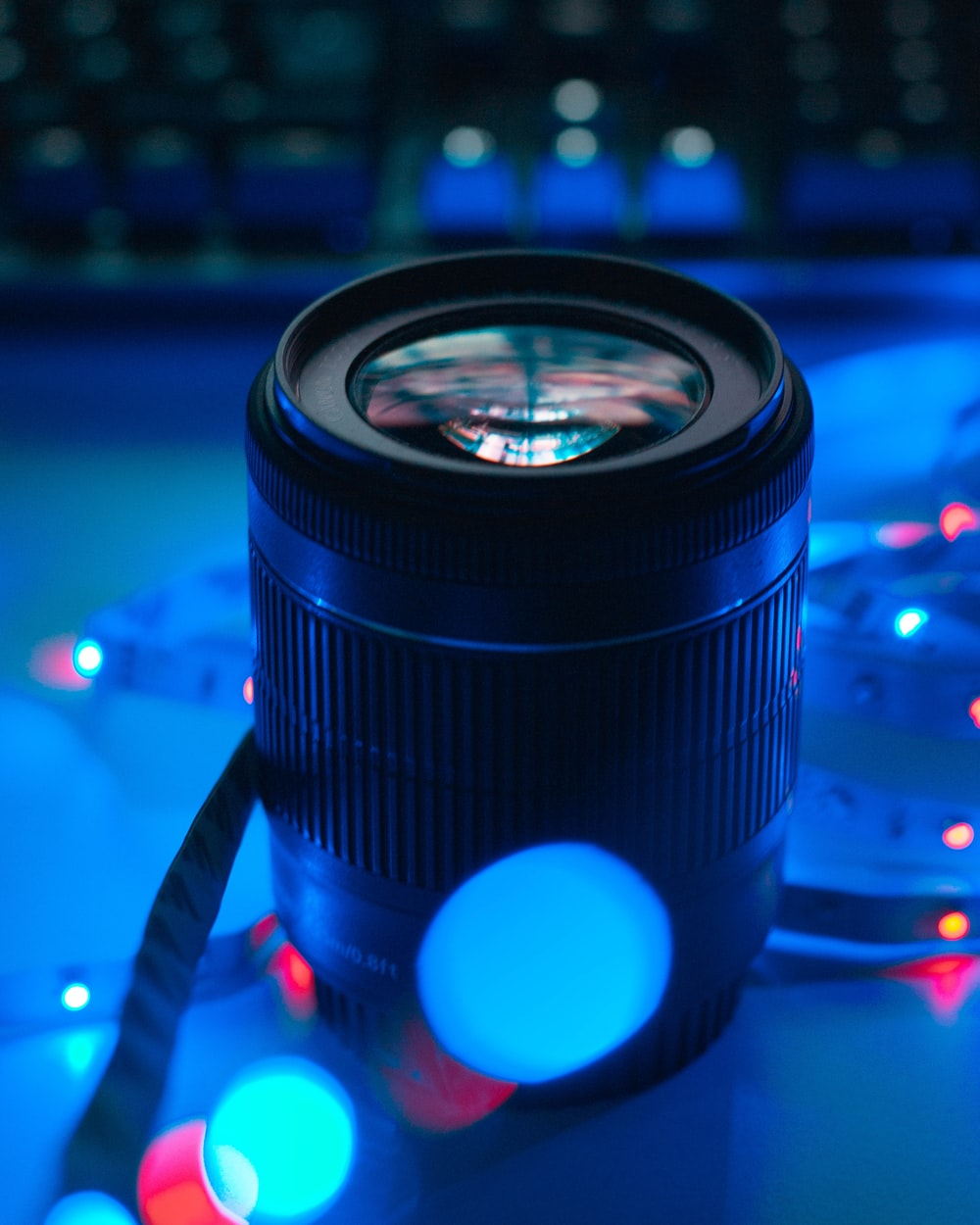 black camera lens with bokeh effect