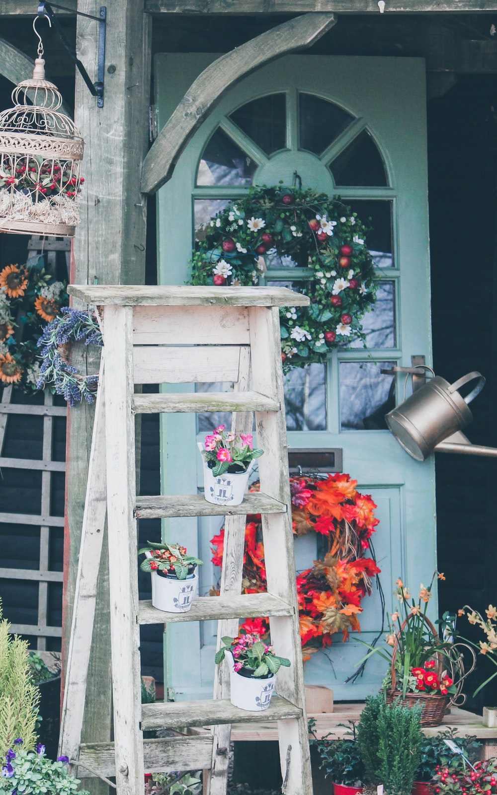 flower pots placed on white wooden ladder