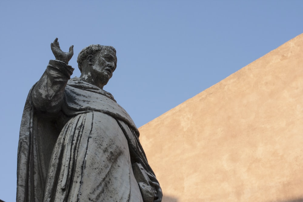 man wearing grey statue