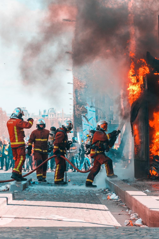 firemen working on building on fire