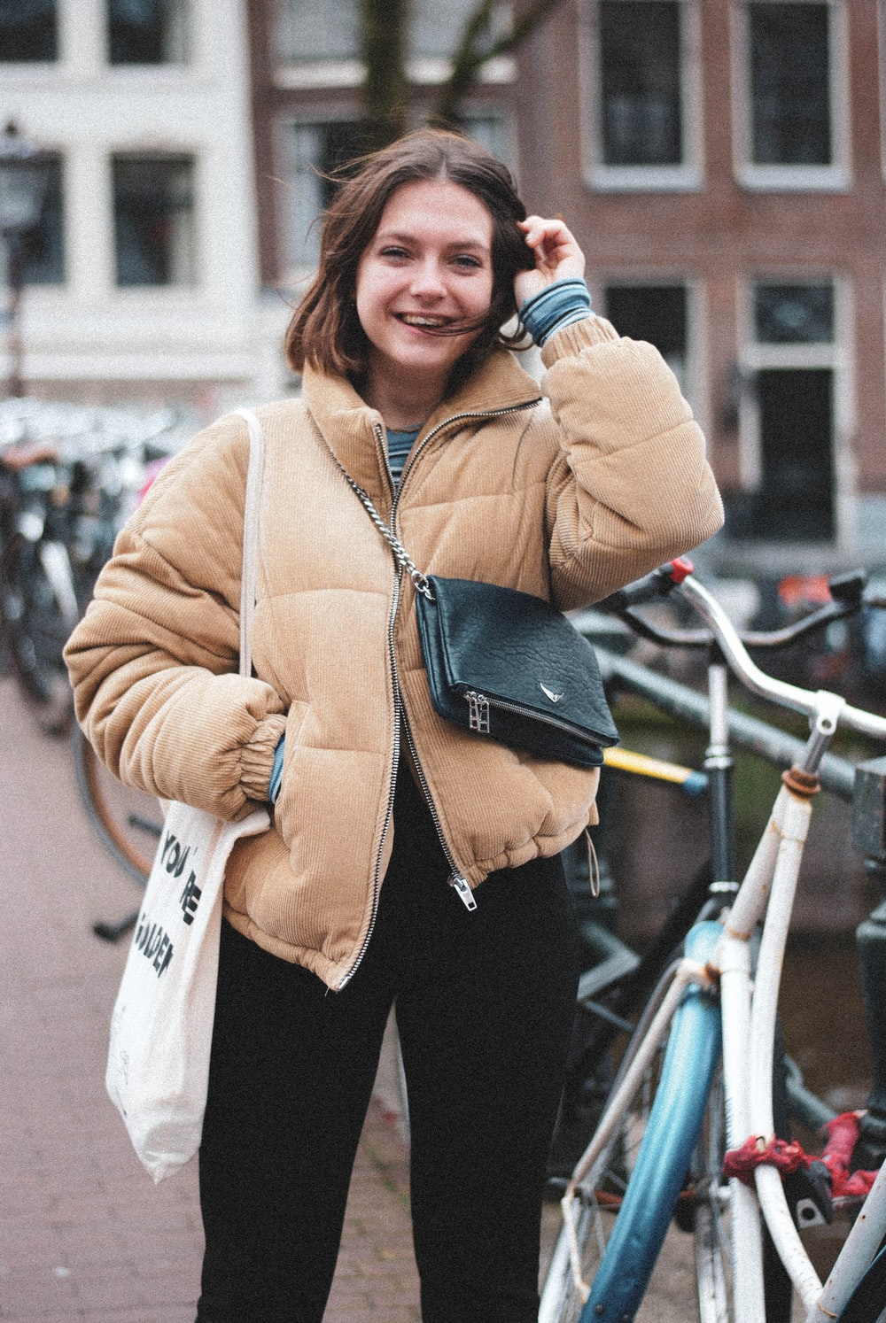 smiling woman wearing brown zip-up bubble jacket