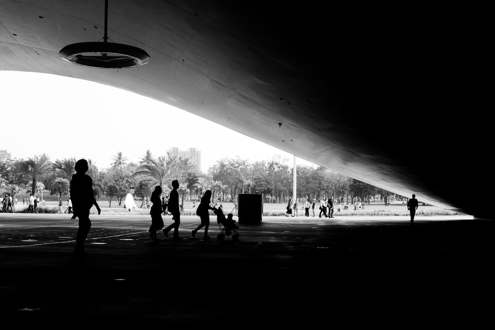 people under concrete roof