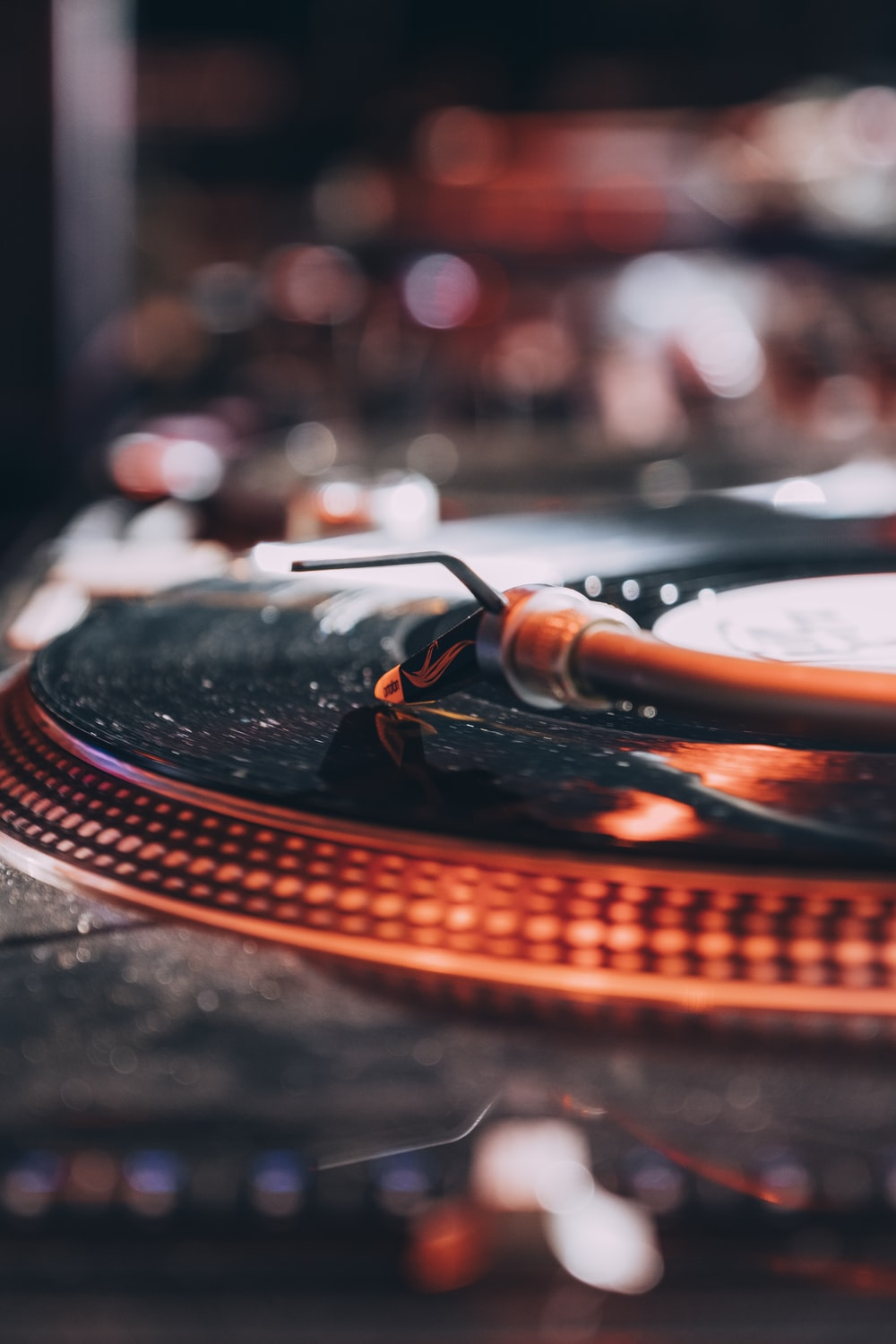 selective focus photo of vinyl disc player with bokeh lights