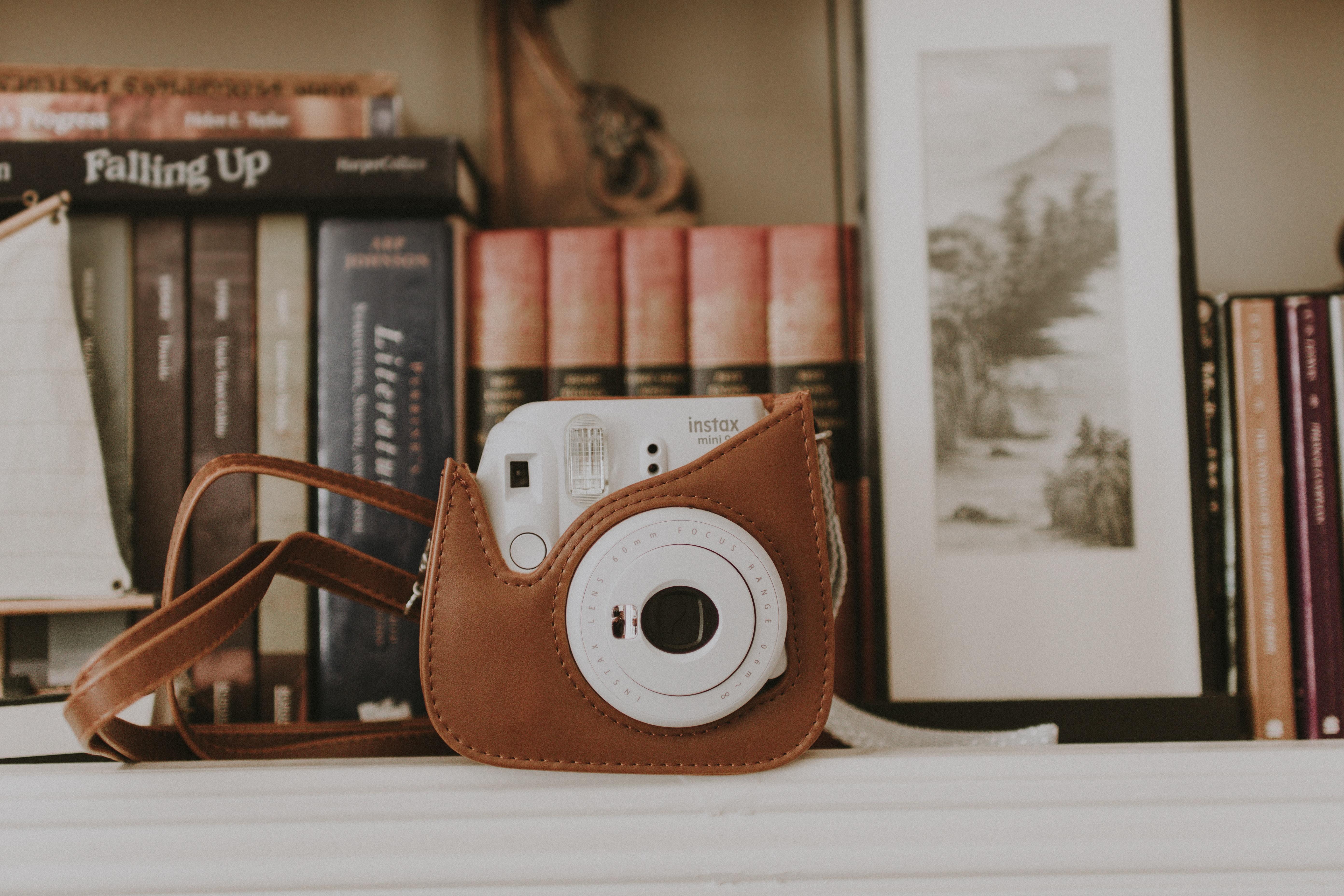 white FujiFilm Instax camera