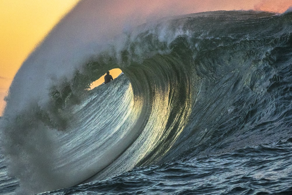 person surfing on waves