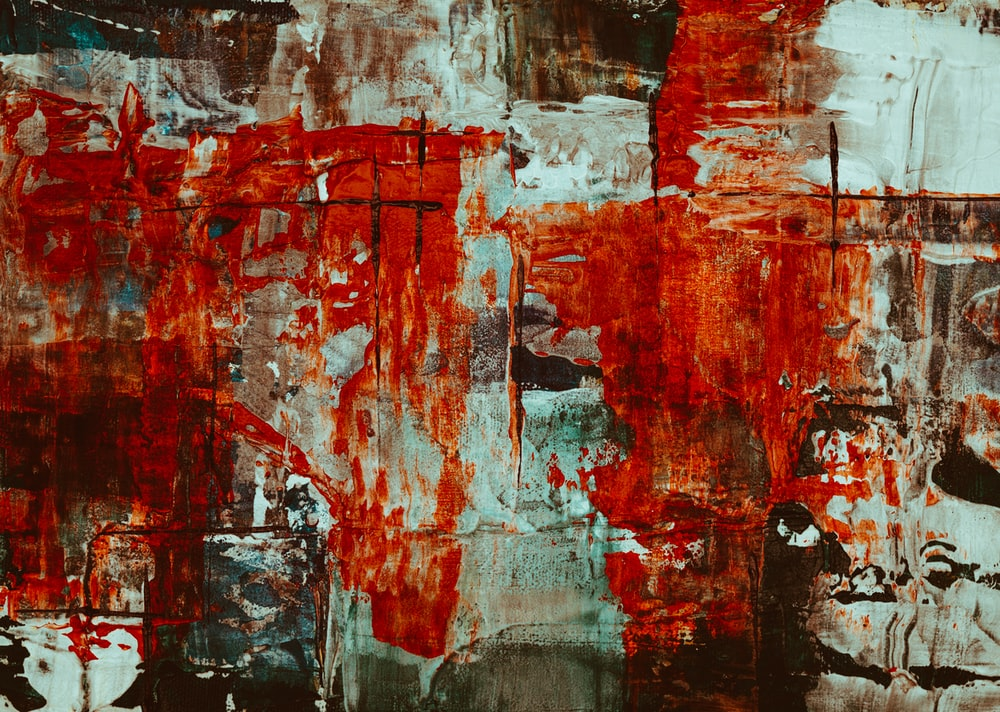 red, white, and brown abstract painting