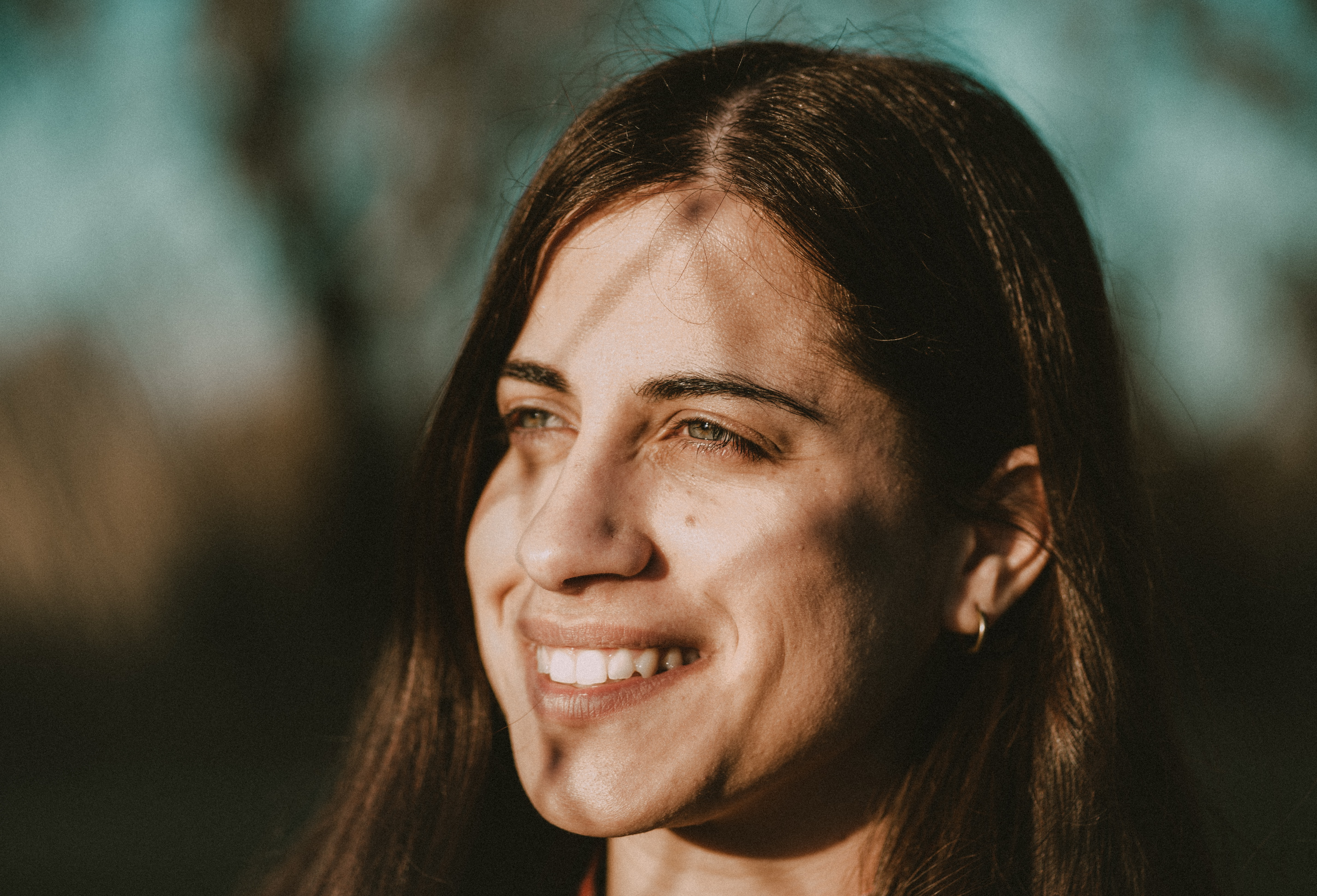 selective focus photography of smiling woman