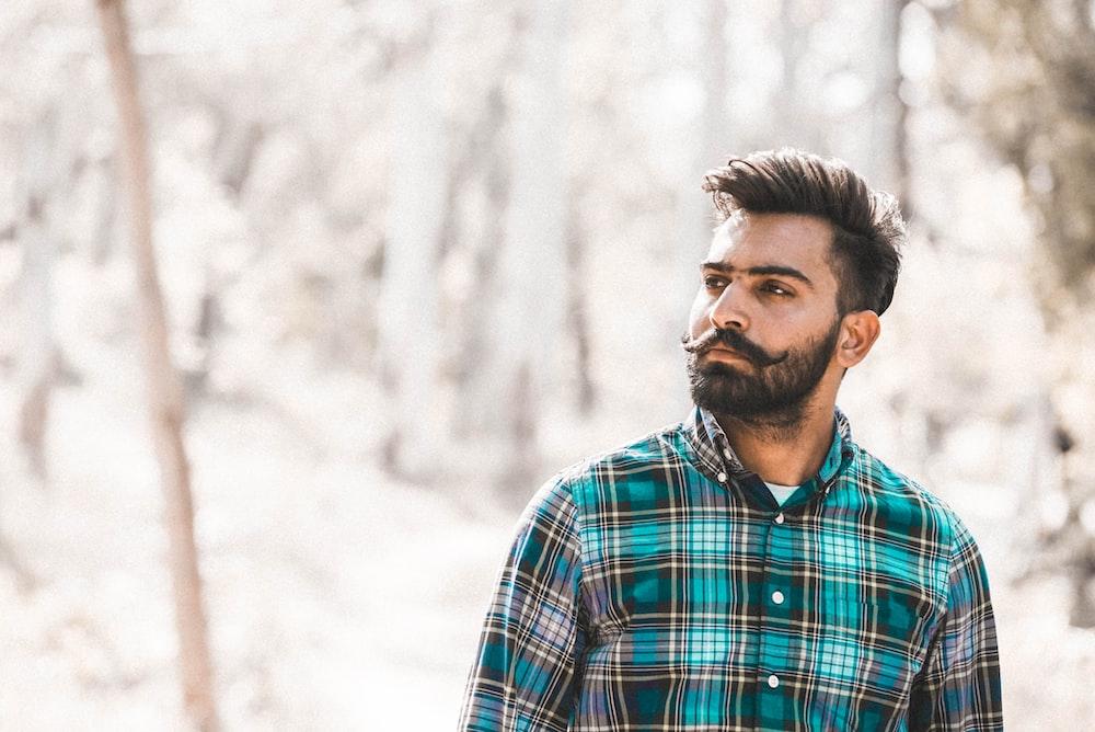 man standing near wood s