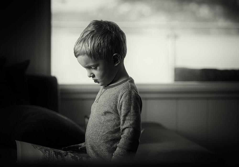 boy wearing gray sweaters