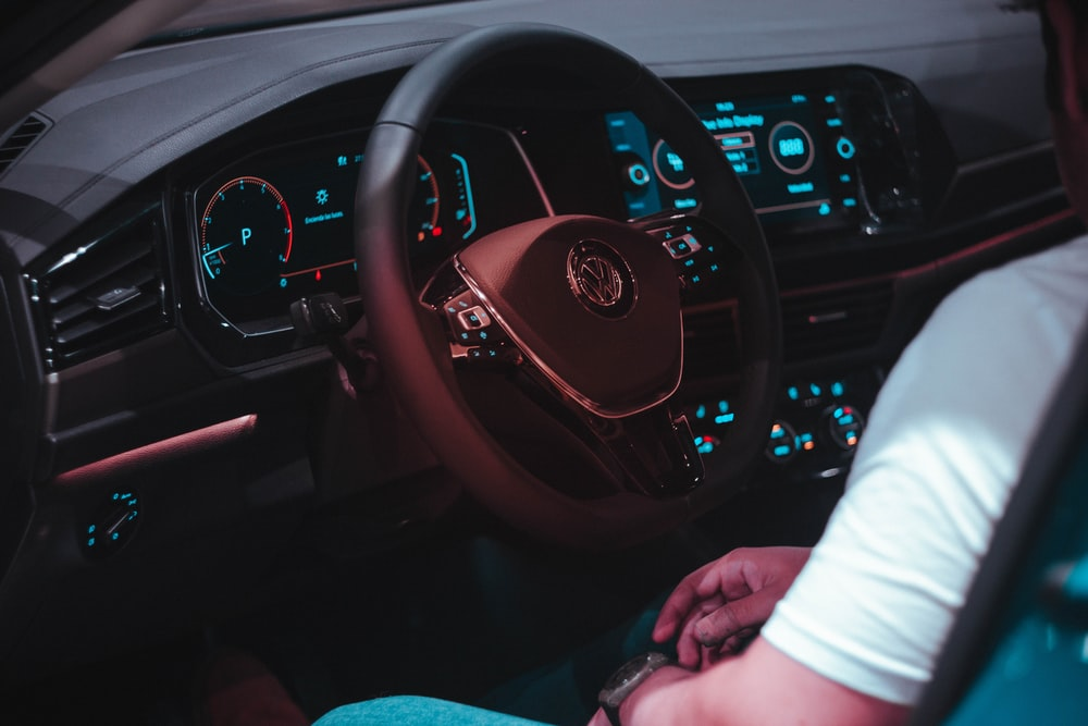 person riding black Volkswagen vehicle
