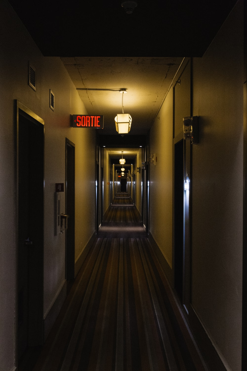 gray and brown wooden hallway