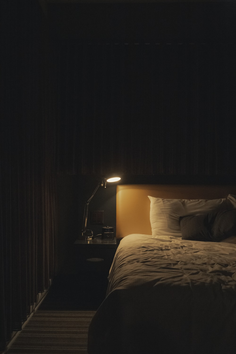 turned on study lamp beside bed