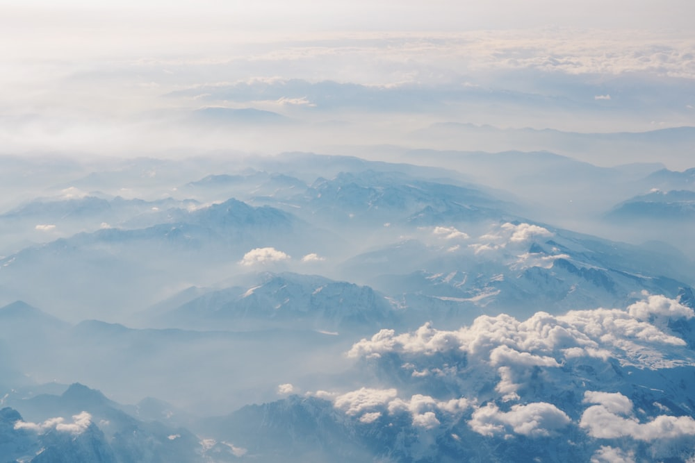 view of mountaintops with clouds