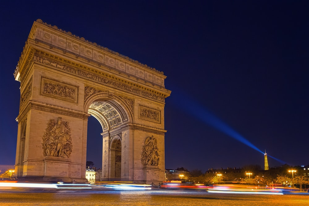 time lapse photography of Arch de Triumph at night