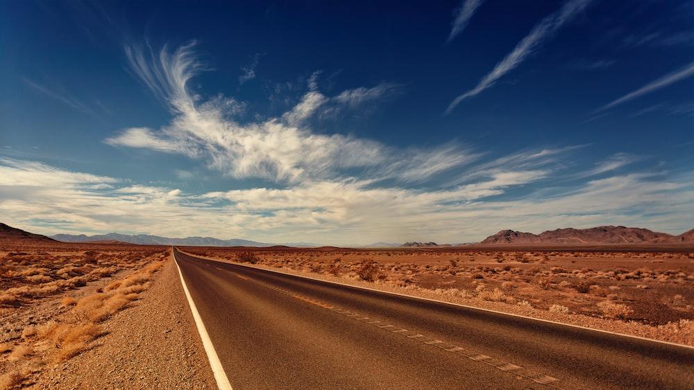 brown concrete road during daytie