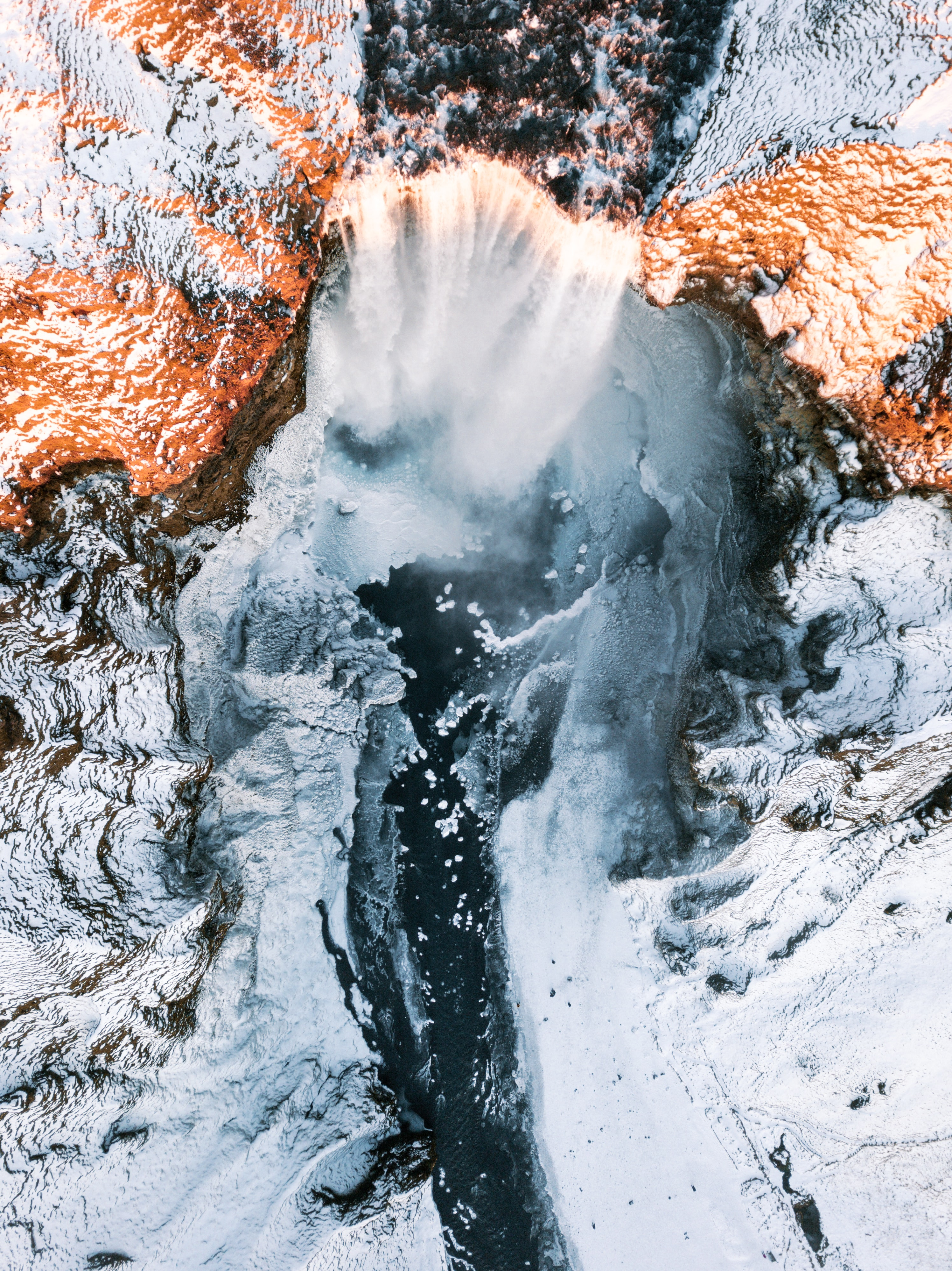 waterfalls in between of white rock formation