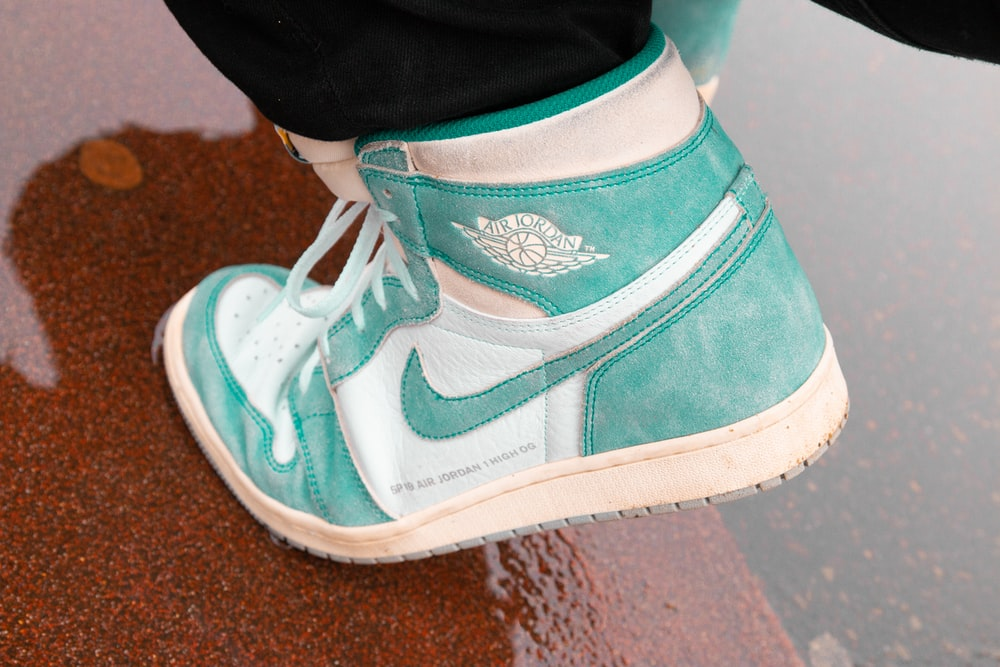 unpaired teal and white Nike Air Jordan 1
