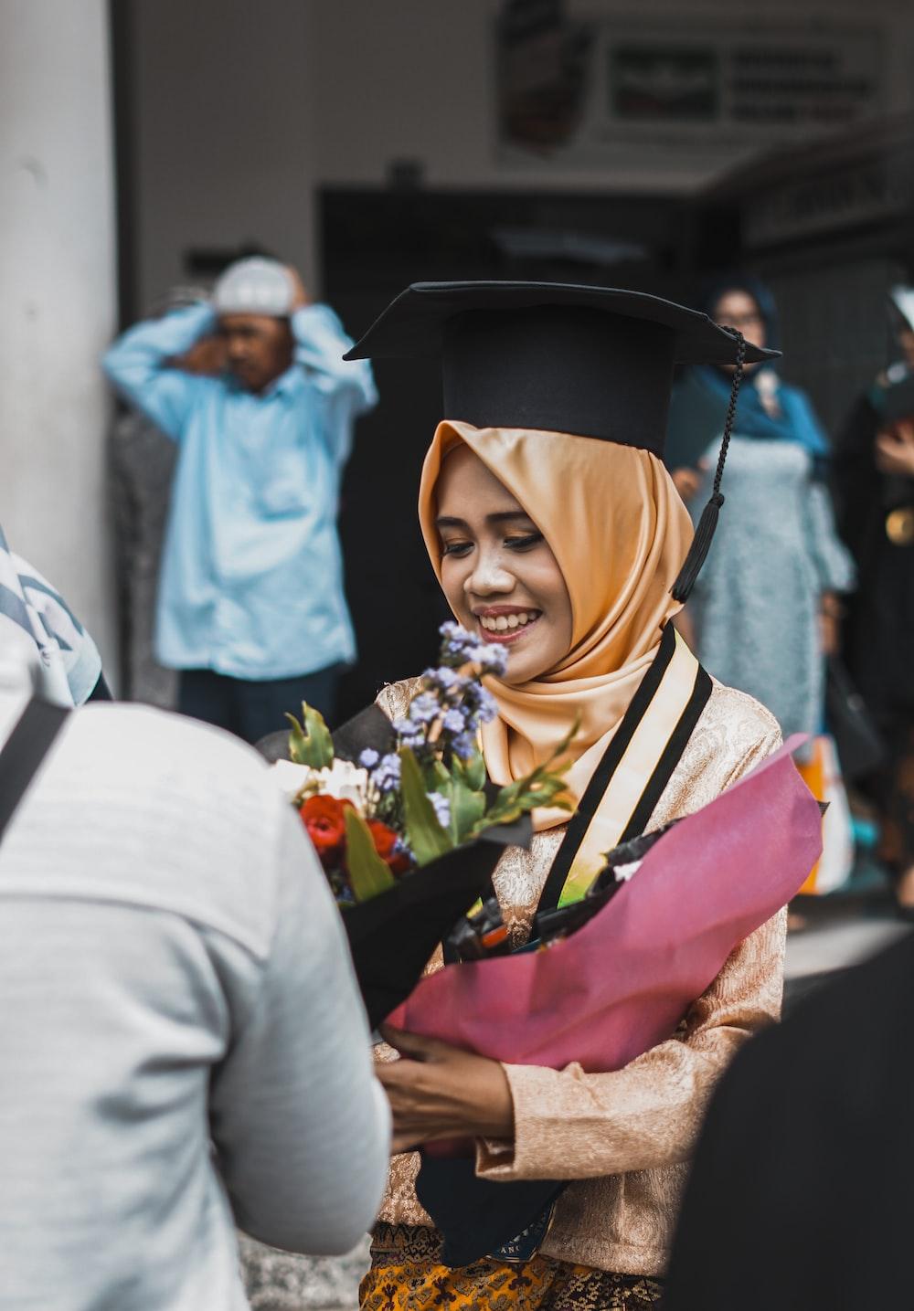 woman receiving bouquet of flowers