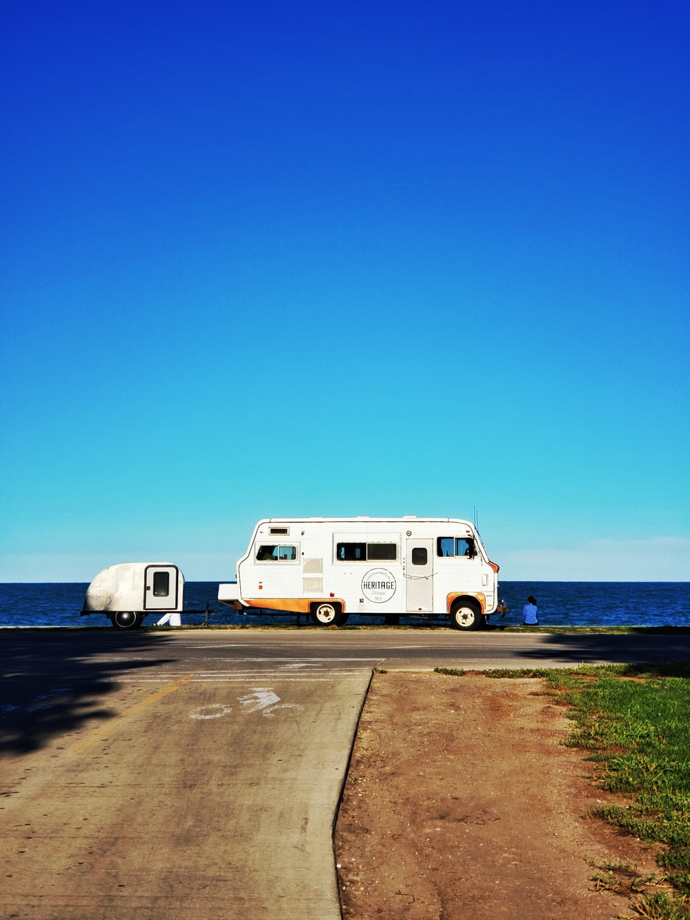 view of a white RV on a roadside